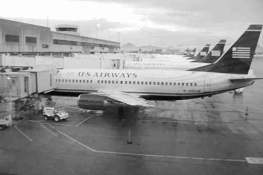 外媒:美国航空与全美航空或将合并成行业巨头