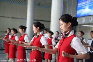 "Stewardesses-to-be practice the basics of the Ving Tsun, a form of self-defense, in Chengdu city, Southwest Sichuan province on Monday. Ving Tsun, or Wing Chun, a concept-based Chinese martial art, has been set as a compulsory course in Sichuan Southwest Vocational College of Civil Aviation. The college has signed a contract with the Tu Tengyao Martial Art Association to develop the course called ""Eighteen combat movements of anti-terror in civil aviation."" Ving Tsun is a system of striking and grappling, especially used for close-range combat. [Photo/IC]"