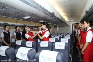 Two students demonstrate Tu's instructions in an A330 flight simulator in Chengdu on Monday. [Photo/IC]