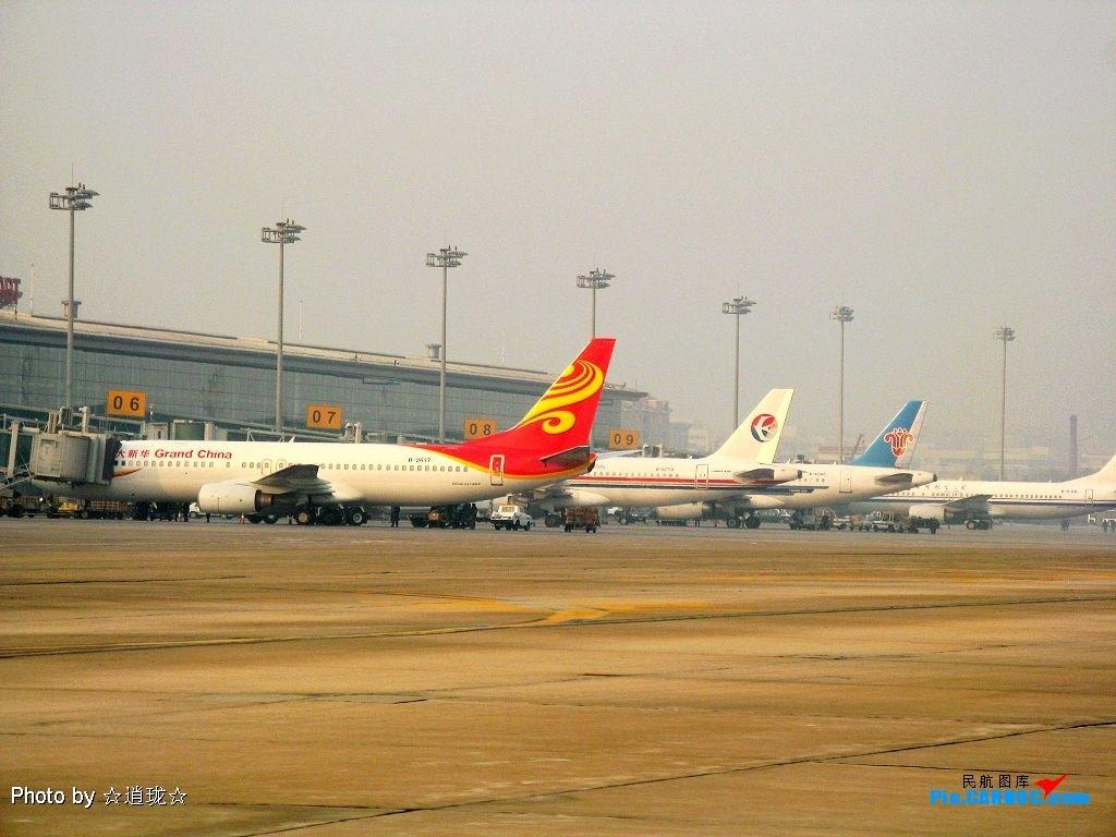 Re:[原创]威猛眼中的大新华航空有限公司首航 BOEING 737-800 B-2637 中国大连周水子机场
