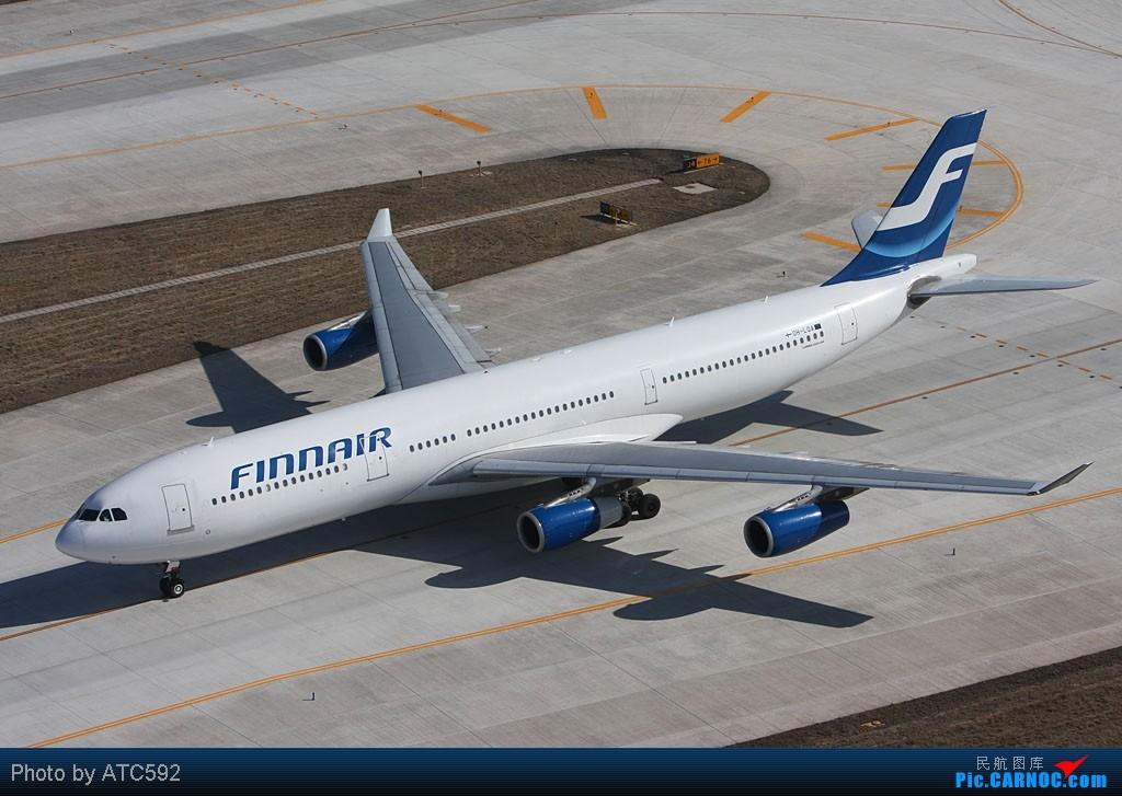 [原创]很久没发帖了,冒个泡。o  O AIRBUS A340-300 OH-LQA 中国北京首都机场