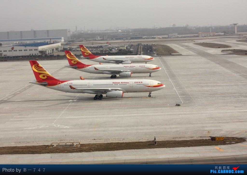 Re:[原创]首都机场同一个镜头里出现两架346,这个可以有 AIRBUS A330-200  PEK