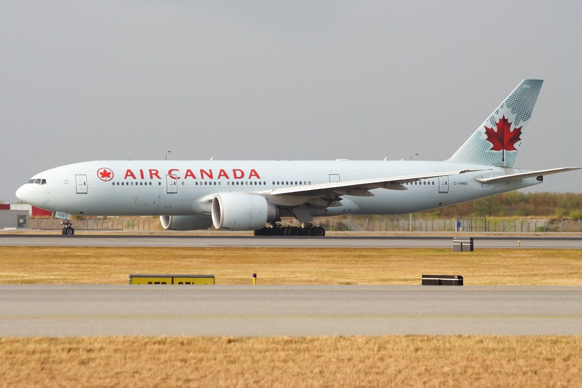 Re:[原创]香港政府飛行服務隊的開放日, 顯然我沒有理會到主人家 BOEING 777-233LR C-FNND 中国香港赤鱲角国际机场