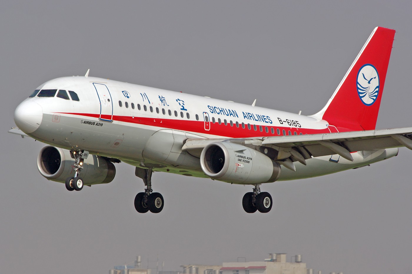 Re:[原创]换个角度、换种天气——非典型的KMG AIRBUS A319-100 B-6185 中国昆明巫家坝机场