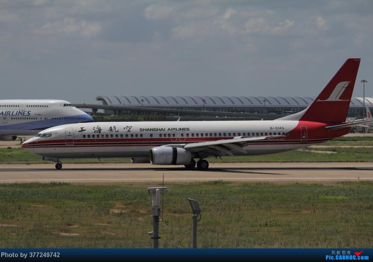Re:[原创]趁着最后的好天气去趟PVG,烂技术请多包涵。西园会、世博320、长荣744、AC763、UA744。回去磁悬浮飙到430KM一刚。 BOEING 737-800 B-5145 中国上海浦东机场