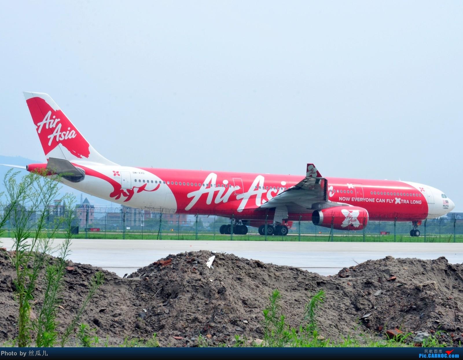 Re:[原创]海葵留下了一片茫茫大地,送完朋友又去六号路溜达,突然发现一个大家伙迎面而来,赶紧拿相机换镜头,开火、爆菊、抵近射击!一气呵成!NND,百密一疏,60的快门! AIRBUS A330-300 9M-XXD 中国杭州萧山机场