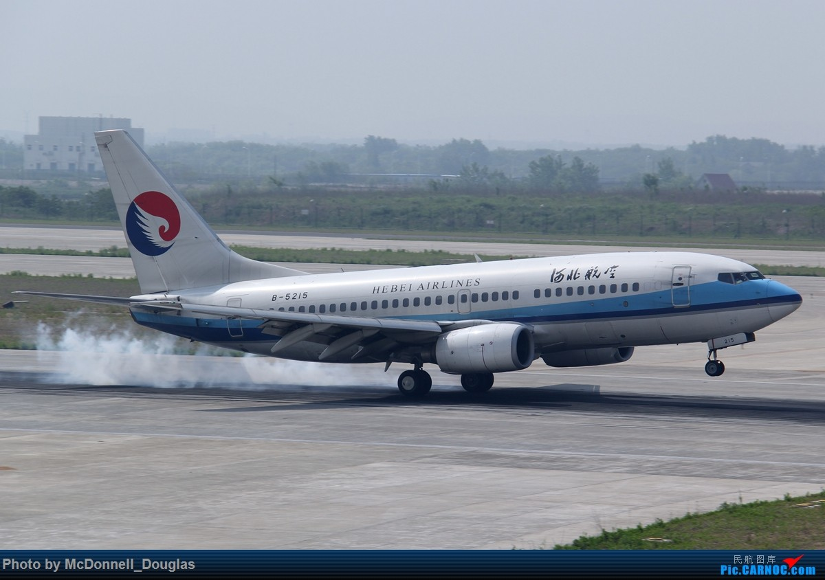 Re:[原创]【上海飞友会】2015.05.01劳动节拍机计划打MD-90偶遇MD-83和三架小190~ BOEING 737-75C B-5215 中国南京禄口国际机场