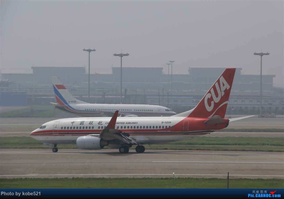 Re:[原创]烂天来好货~~ BOEING 737-700 B-5209 中国杭州萧山国际机场