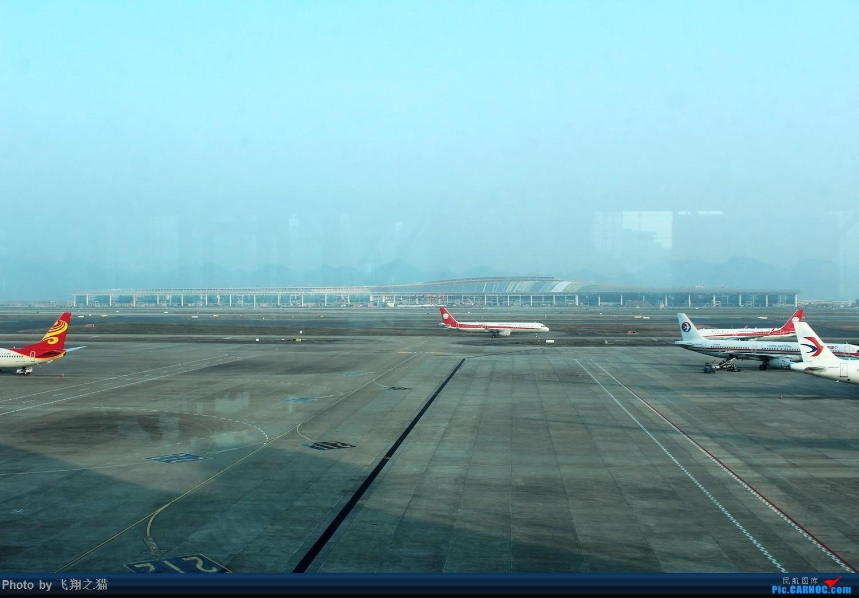 Re:[原创]CKG拍机(新年第一拍,川农th100,巧遇海航长安银行,小门神彩绘)    中国重庆江北国际机场