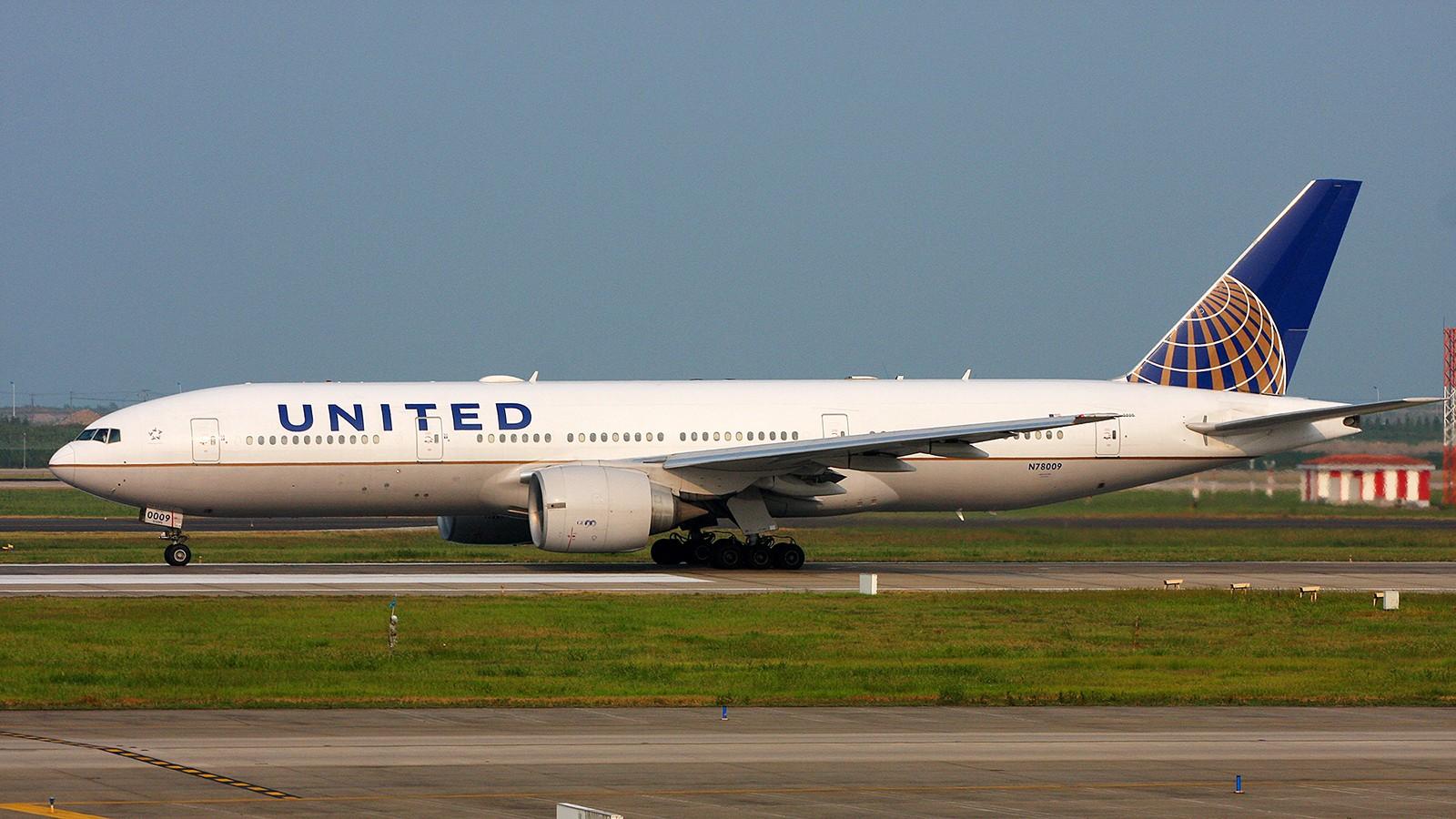 Re:[原创]天气欠佳,深入PVG,34端拍机 BOEING 777-200ER N78009 中国上海浦东国际机场