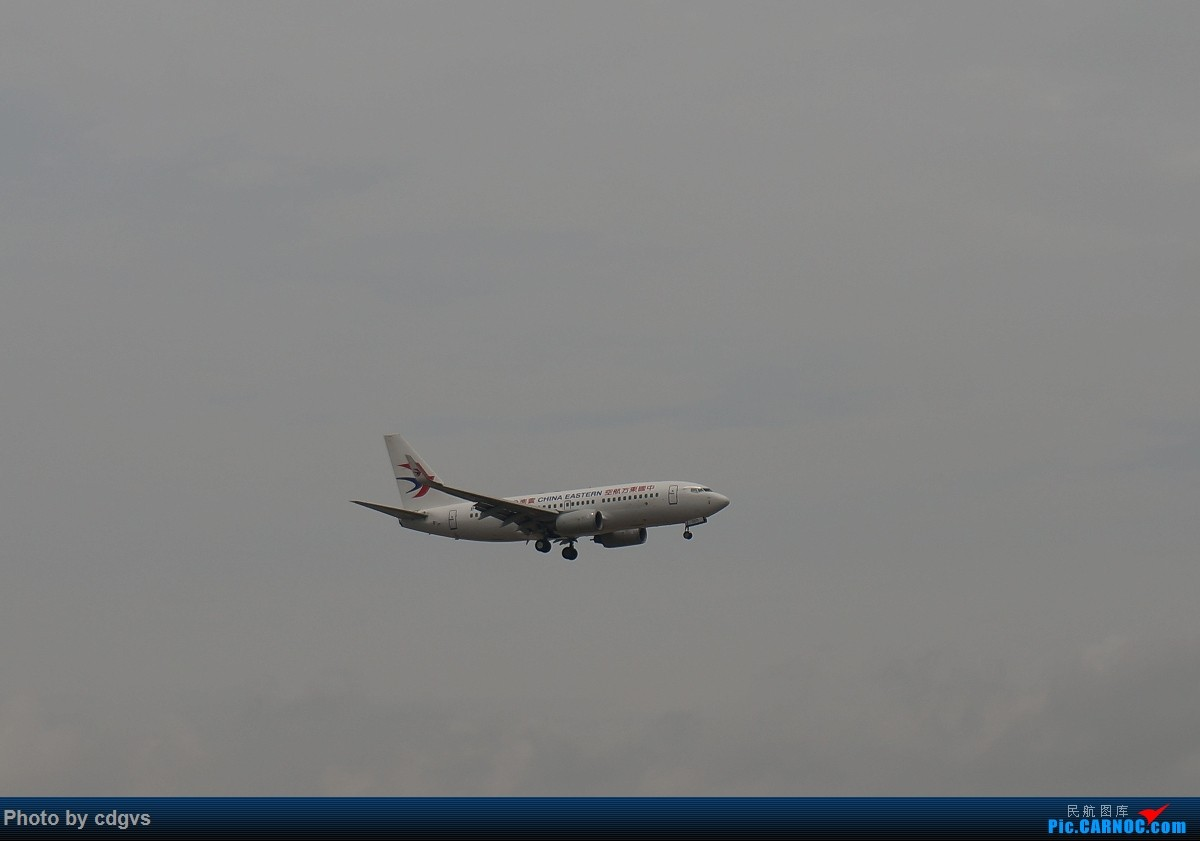 Re:[原创]【KMG】阴天独游长水,有宽体,有彩绘 BOEING 737-700  中国昆明长水国际机场